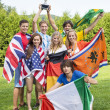 Athletes With Various National Flags Celebrating In Park — Stock Photo #31971891
