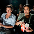 Men watching movie in cinema — Stock Photo