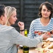 Friends enjoying dinner party outside — Stock Photo