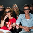 Friends watching 3D movie at cinema  — ストック写真