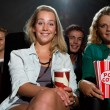 Friends watching movie at cinema  — Stock Photo