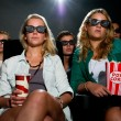 Friends watching 3D movie at cinema  — Stock Photo