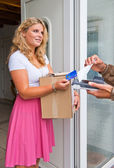 Housewife accepting package — Stock Photo
