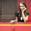 Woman Leaning On Railing In Red Caboose Car — Stock Photo #32519503