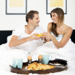 Breakfast in bed — Stock Photo