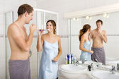 Couple brushing Teeth — Stock Photo