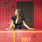 Woman Standing On A Red Caboose — Stock Photo