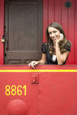 Woman Leaning On Railing In Red Train Caboose Car — Stock Photo