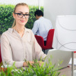 Woman in a hot desk office — Stock Photo