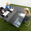 Environmentalists Sitting At Desk In Office — Stock Photo