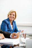 Happy Businesswoman In Conference Room — Stock Photo