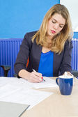 Concentrated woman working — Stock Photo
