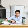Young man sits at the table — Stock Photo #39424677