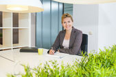 Confident looking business woman — Stock Photo