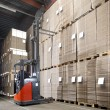 Forklift lifting from top shelf — Stock Photo #49686705