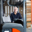 Posing reach truck driver — Stock Photo