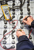 Battery check with multimeter — Stock Photo