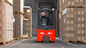 Forklift driving backwards — Stock Photo