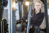 Forklift driver posing — Stock Photo