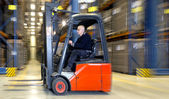 Forklift in warehouse — Stock Photo