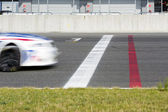 Race car Crossing the finish line — Stock Photo