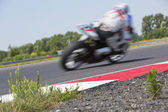 Motorcycle racer on circuit — Stock Photo
