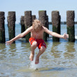 Boy jumps in sea — Stock Photo #6185726