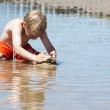 Boy plays with sand — Stock Photo #6185798
