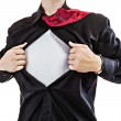 Young business man tearing apart his shirt revealing a superhero suit — Stock Photo #12568963