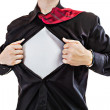 Young business man tearing apart his shirt revealing a superhero suit — Stock Photo