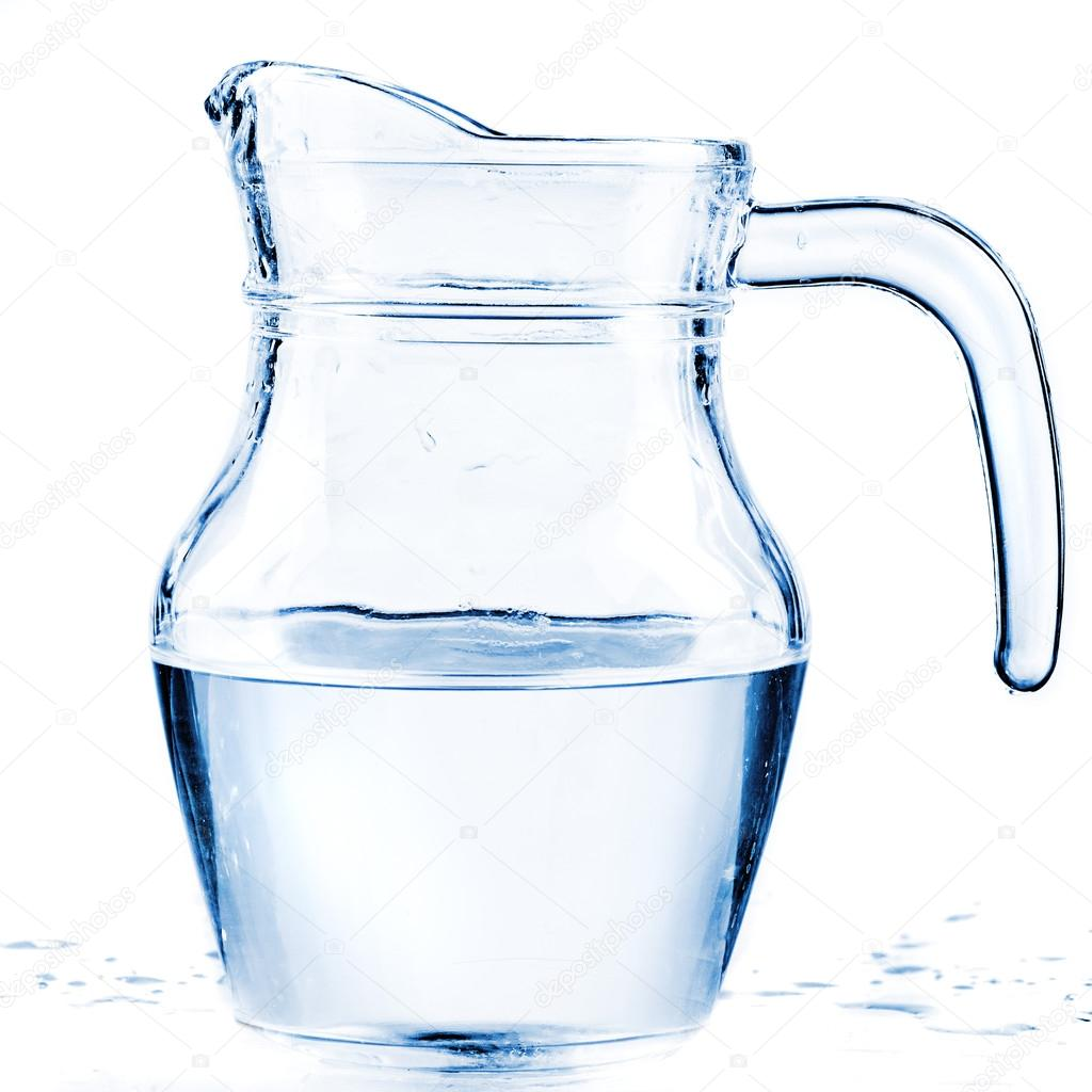 fresh water in a glass pitcher � stock photo