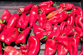 Fresh red peppers, street market — Stock Photo