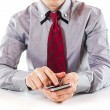 Close up of a business man using a mobile phone — Stock Photo #13643955