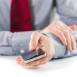 Close up of a business man using a mobile phone — Stock Photo