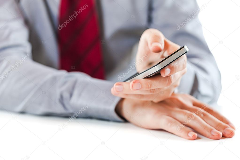 Close up of a business man using a mobile phone  Stock Photo #13643976