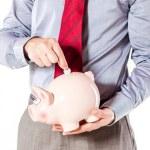 affärsman som innehar en gris bank - ekonomin besparingar — Stockfoto #13753187