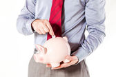 Business man holding a pig bank - economy savings — Stock Photo