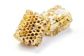 Bienenwabe auf weißem hintergrund — Stockfoto