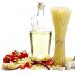 Italian pasta with tomatoes, garlic and olive oil on white backgroun — Stock Photo