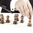 Business man and chess figures, business concept — Stock Photo