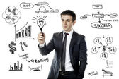 Young businessman and business plan — Stock Photo