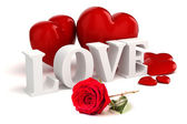 3d Love text and big red hearts on white background — Stock Photo