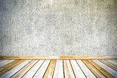 Vintage concrete wall and wooden floor background — Stock Photo