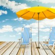 Sun loungers and umbrella — Stock Photo