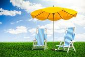 Sun loungers and umbrella — Stock Photo