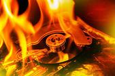 燃烧的计算机硬盘上 — 图库照片