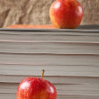 Red apple and books — Stock Photo