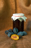 Plum on table and a punnet — Stock Photo