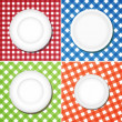 White plates on checkered tablecloth — Stock Photo