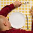 Man sleeping at the dinner table — Stock Photo
